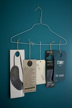 Collection of paper-things...hang from hanger! The color of the wall is divine, by the way.