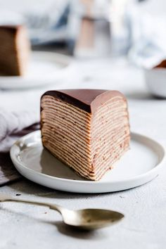 Delicious and surprisingly easy recipe for chocolate crepe cake from Anna Banana Co. Beautiful layers of soft crepes with whipped chocolate cream create this visually stunning cake, making it perfect for any occasion! Crepe Cake Chocolate, Chocolate Pancakes, Chocolate Ganache, Banana Recipes, Easy Cake Recipes, Sweet Recipes, Köstliche Desserts, Delicious Desserts, Dessert Recipes