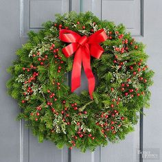 Balsam fir creates a classic and full wreath, while colorful berries and boxwood greens enhance the traditional holiday greenery. A bright red matching bow ties the adornment together./