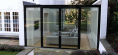 IQ designed and built this slick glass assembly using some of the latest technologies around including a 'Flush' Glass door, bonding the glass to the door frame to give a streamline finish. Lean To Conservatory, Glass Extension, Glass Room, Villa, Glass Boxes, House Extensions, Modern Glass, Mid Century House, Home Reno