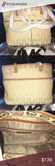 """NWT Michael Kors Kempton New MK Kempton in Signature Cream and Mocha (tan) Saffiano leather. This bag is fully loaded! 1 zip and 4 slip pockets inside, the exterior has 2 zipping pockets in front and 2 slip in the back! Fully loaded! Has the MK lock not emblem, gold hardware, double handle drop is 10"""" bag measures 11 X 10 X 5 MICHAEL Michael Kors Bags Shoulder Bags"""