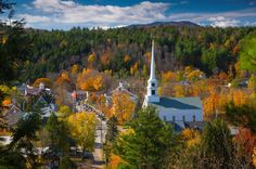 © Alan Copson/Getty Images Fall foliage tour of New England.The quintessential Vermont village of Stowe is found in a cozy valley where the West Branch River flows into the Little River and mountains rise to the sky in all directions. Vacation Destinations, Vacation Spots, Vacations, Places To Travel, Places To See, Travel Stuff, Small Town America, North America, Just Dream