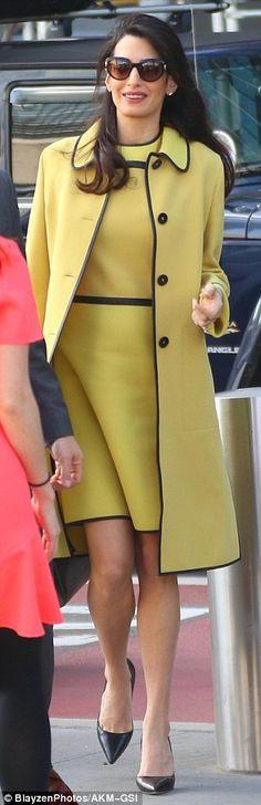 Amal Clooney dresses her burgeoning bump in a pretty yellow dress #dailymail