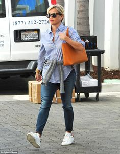Working 9-5: Adding a touch of office attire to her ensemble, the mother-of-three wore a s...