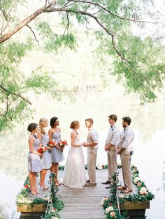 Bride dresses in Kate McDonald Bridal McCants gown / Bridesmaids dressed in LulaKate garden stripe and  seersucker dresses / Photo courtesy of Southern Weddings Magazine