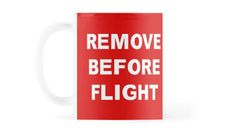 """Red mug with a """"Remove Before Flight"""" warning in white letters / Copyright: Escarpatte Red Mug, White Letters, Cool Designs, How To Remove, Mugs, Glasses, Tableware, Shirt, Stuff To Buy"""