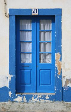 A typical doorway to one of the little fisherman's cottages in the centre of Ericeira. The blue and white theme runs throughout the town