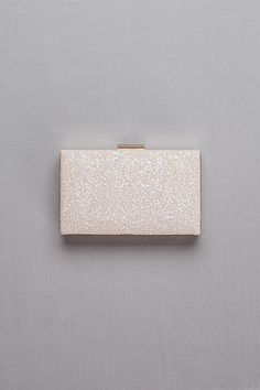 On-trend rose gold metal and iridescent glitter form the season\'s most ladylike clutch.   Glitter, metal, satin  Removable chain strap  Top clasp closure  4.5 H, 7.5 W, 1 D  Imported