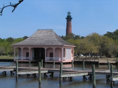 Looking from The Whalehead Club over the boat house to The Lighthouse at The Currituck Heritage Park in Corolla NC