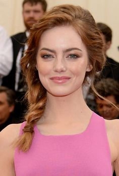 Met Gala 2014 Hair and Makeup: 13 amazing Met hair and makeup looks.  Emma Stone's cool-girl side braid and bronze-y makeup.