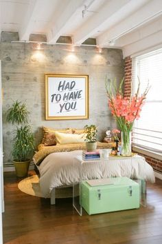 Cute bedroom style. Wood wall with mint green.