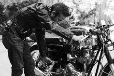 Doing stuff to his bike...