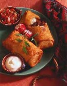 Spicy beef chimichanga - rob recipe (obv)..his favorite tex-mex dinner :) this was a surprisingly quick recipe, would def make again on a weeknight! i fried two and baked two, both were easy to make...rob gives two thumbs up for taste =)