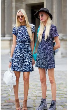 Navy and white print dresses, paired with light blue and white bags