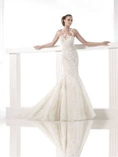 As Spanish bridal house Pronovias celebrates its 50th anniversary, we take a look at their latest 2015 wedding dress collection, which features layers of tulle, dazzling gemstones and figure-enhancing cuts