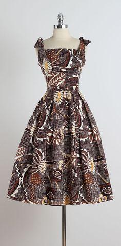 1950s Liberty House Tiki Print Hawaiian Dress island girl brown black floral wax print look
