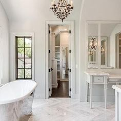 White and Gray French Style Bathroom with Marble Herringbone Tile Floor