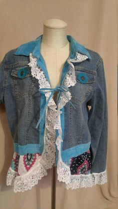one of a kind denim jacket and aqua leather trim white lace accents polyester fabric at bottom of jacket (pink, white, aqua) Directions on jacket say to hand wash size large small pink stain on collar to right side of neck. I tried to show it as well as possible in photo