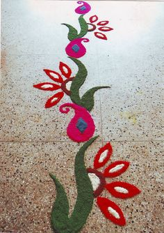 Rangoli made of colored rice grains