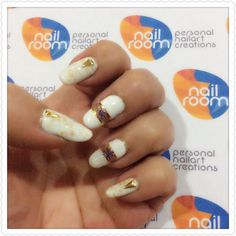 Christmas nailart. White nails with gold flakes n accent nailart