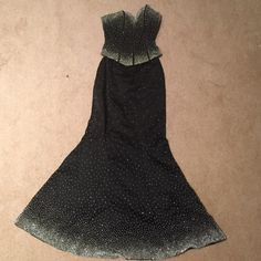 Prom! Two piece strapless gown Black gown with white beading and rhinestones. Gown is two pieces: a top and skirt. Worn once. Great condition. Dresses Prom