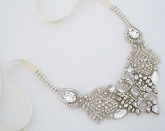 Erin Cole Embroidered Crystal Bib Necklace.  Various crystal shapes & rock crystals sparkle on re-embroidered ivory netting. Intricate details, statement piece.
