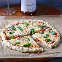 Delicious chewy grain-free pizza crust. Crust is vegan + recipe includes vegan topping options | on myrecipemagic.com
