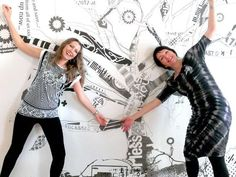 Rosanne Lawton and and artist Jodie Connolly in front of one of Jodies large scale artworks on display at Paxtons last August. Work is called 'trees for the twigs and leaves' (digital collage printed with ecosolvent ink on phototex, size 390cm x 240cm) Contributed