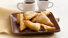 Chocolate. Hazelnut. Caramel. Not sold yet? These crescent sopapillas are fried and sprinkled with powdered sugar. Go on, try to resist!