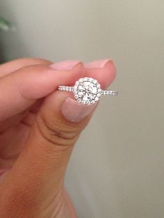 I'm so in love. Ritani engagement ring, round center diamond, french set with a halo.
