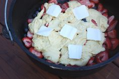 Dutchoven strawberry/blueberry cobbler, made from cake mix, sprite, and fresh berries