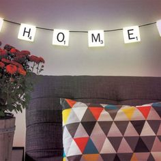 A string of 10 Scrabble letter tiles & 60 reusable letter stickers make Scrabble String Lights. Scrabble String Lights make personalised lighting, buy at The Glow Company