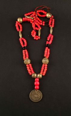 Old vintage red beads and coins necklace from by ethnicadornment