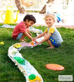 Float your kid's boat: Create a faux river running through your yard with a hose and some heavy-duty aluminum foil. Unroll two layers of foil to your desired length, and fold their outer edges up to create a path for the water to flow through. Turn the hose on low and let your child sail water toys merrily down the stream.river
