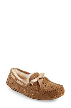 Crushing on these cozy moccasin slippers from UGG Australia that have geometric cutouts, allowing shimmery metallic backing to shine through. These will be perfect for lounging around the house.