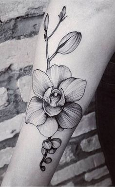 Gray-Scaled Orchid Tattoo. Although colored tattoos look beautiful, but the grace of the gray-scaled tattoos is seamless.