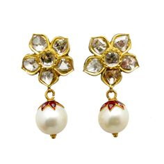 Beautiful Mughal style diamond earrings set in 22 karat gold with a pearl drop. The front is set with approximately 3.5 carats of rose cut diamonds while the reverse is enameled in exquisite detail.