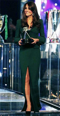 Kate Middleton wearing a forest green gown by Alexander McQueen - tasteful slit; balanced by full sleeves.