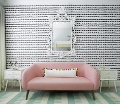 Rethink Design Studio Pink settee sofa, ferm living wall paper, aqua rug. So pretty!