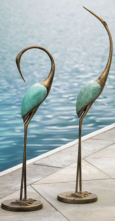 Bring exotic new life to your patio or pool deck with our dramatically sculptural Outdoor Crane Pair.