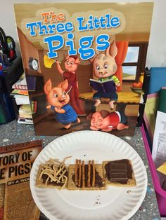 JCYS Northwest Family Center was doing a theme based on fairy tales, and created this project for The Three Little Pigs.  Our teacher, Lynda, gave each child three graham crackers for each of the pigs' houses and put melted chocolate on each cracker.  Chow mein noodles were used for the first little pig's straw  house, pretzel sticks for the second little pig's house of sticks, and two pieces of a chocolate bar for the third little pigs brick house. The children had a blast!