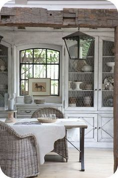 Shabby Chic Cottage Decor - Antique built-in white cabinets utilize chicken wire in place of glass.  You'd have to dust more often, but the chicken wire lends a farmhouse air.