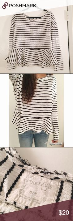 Free People sweater Free People peplum, striped sweater. Thin material, but cozy. Baggy fit and cute design. Lightly worn, in good condition! No holes or tears. Can be dressed up or down! Free People Sweaters Crew & Scoop Necks