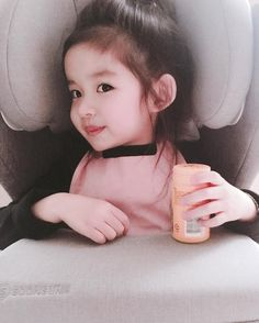Look at her .isn't she adorable. Mmm, actually we Asians r always adorable.