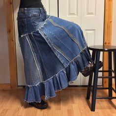 One of a kind long denim prairie skirt is handmade from several pairs of recycled blue jeans! Unique design blends classic denim look with a rustic folk flare to suite many different styles and occasions. Refashioned blue jean skirt is a combination of 100% cotton and stretch denim. Denim