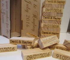 Another design by Senaxus Laser craft  Personalised Handmade wedding jenga style guest book all pieces are Personalised.  This beautiful and unique