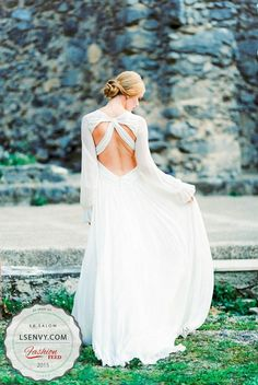 Love having the open back with the covered sleeves. Demure yet sexy. #weddings #weddingdresses #weddinggown #bridal #bride#s #lesalonbridal #boho #openback #sleeves