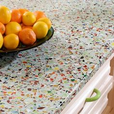 Sturdy, Striking Recycled Glass With Cement for countertop....  Beautiful color creating a cheerful look for the kitchen!  For help with your new kitchen design:  www.ggdesigninspirations.com