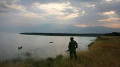 A Congolese park ranger looks over Lake Edwards July 21, 2006 in the Virunga National Park in eastern Democratic Republic of Congo.