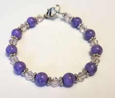 purple and clear bracelet sold on eBay at stores.ebay.com/miasbeadmania